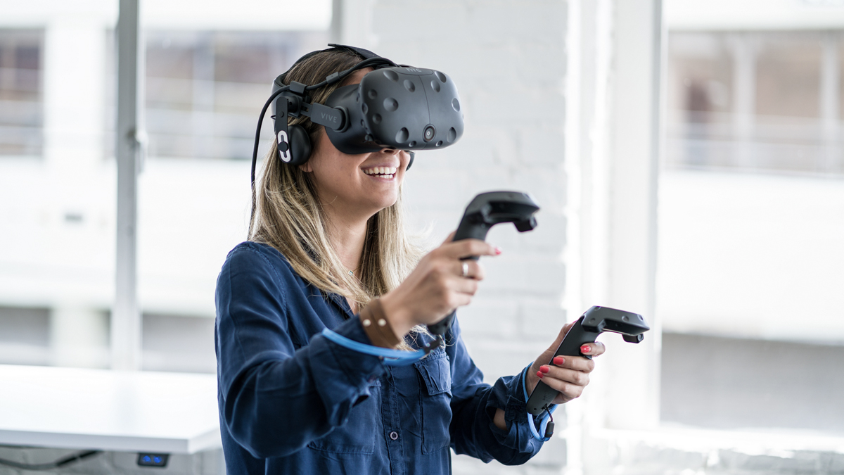 Women wearing virtual reality goggles